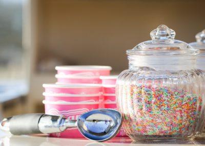 Close up, sprinkles, tubs and scoop